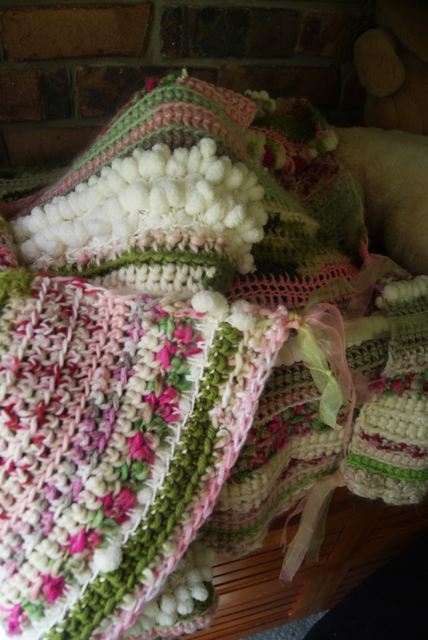 Molly's new crochet blankie. She calls it 'flower garden blankie.'